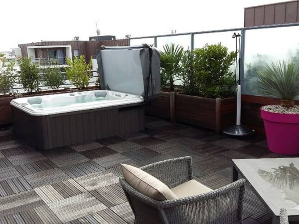 sundance-hot-tub-deck-installation-roof-top-Amherst