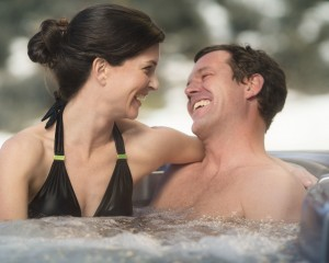 Woman and man soaking in a hot tub.