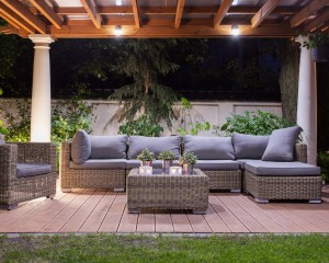 Gazebo on a backyard patio with outdoor furniture underneath.