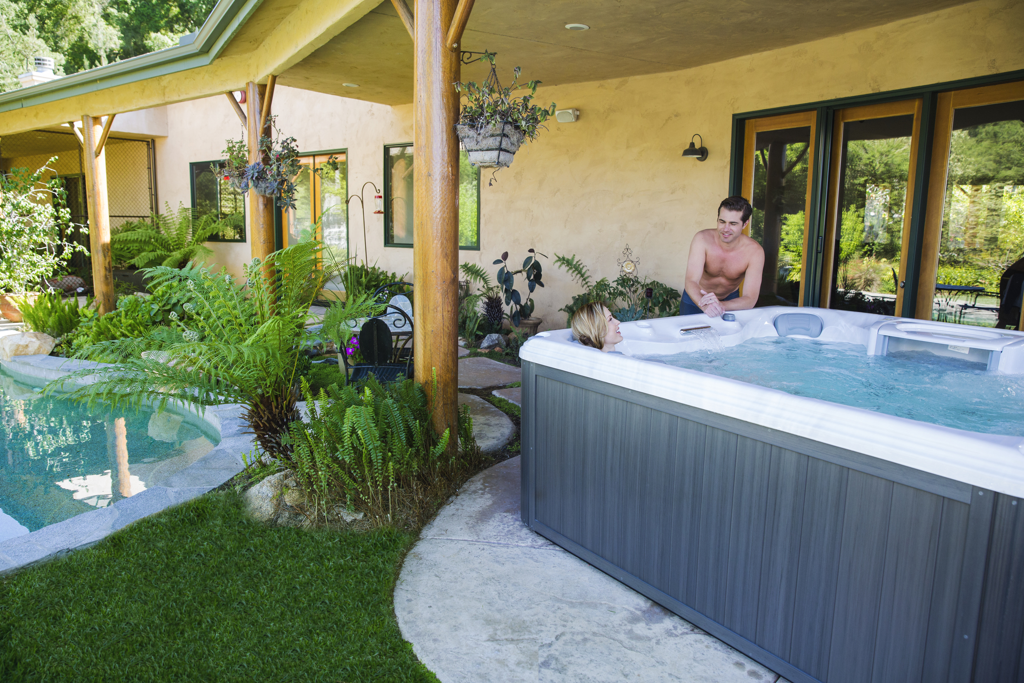 Woman soaking in a Sundance Spas hot tub.