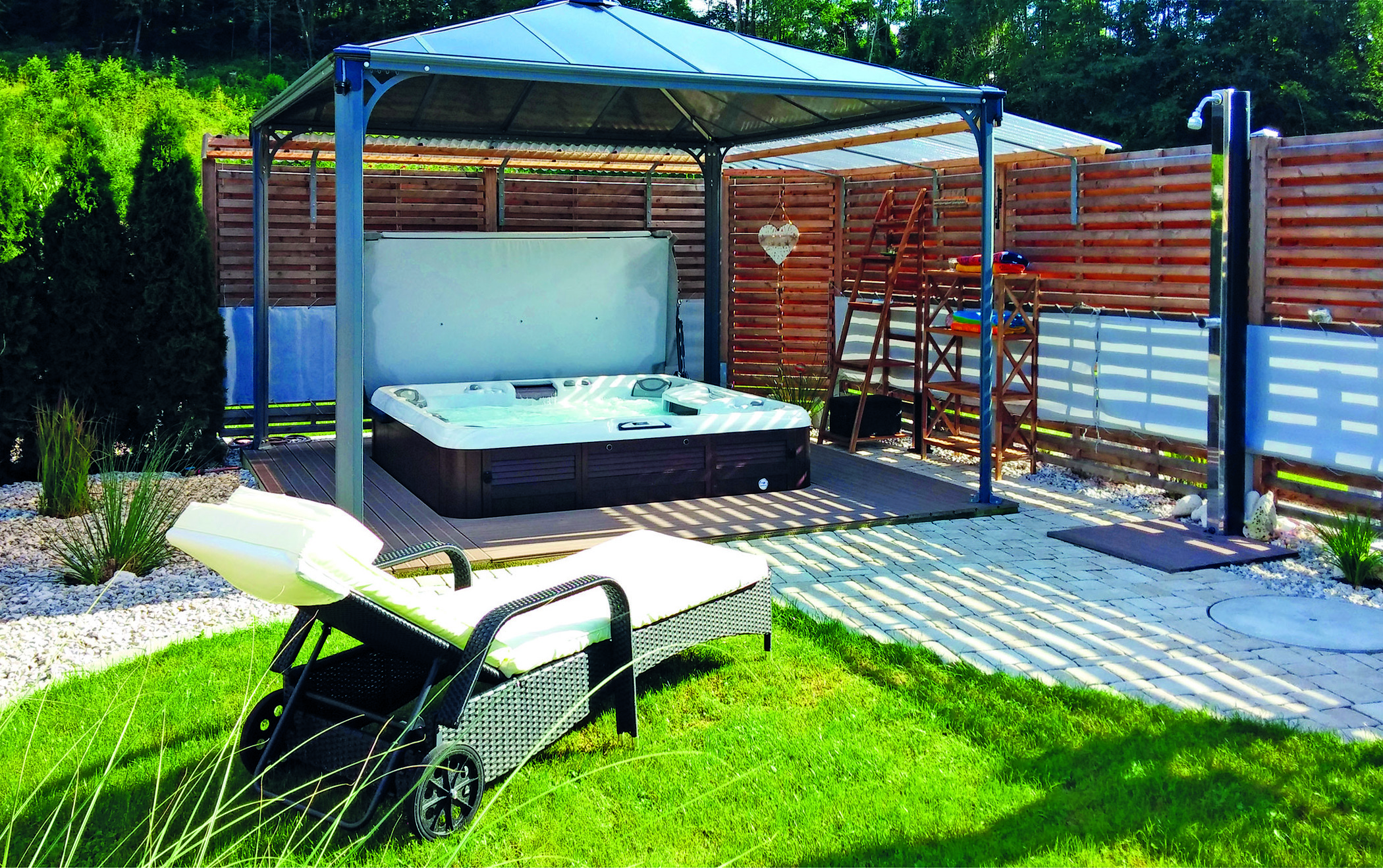 Gazebo and hot tub backyard installation.