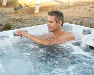 Man soaking in a hot tub