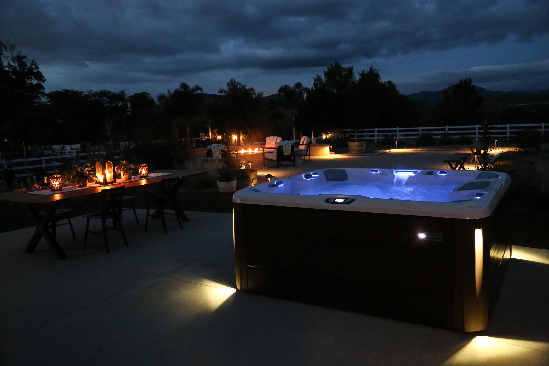Outdoor hot tub at night.