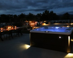 Outdoor hot tub at night.