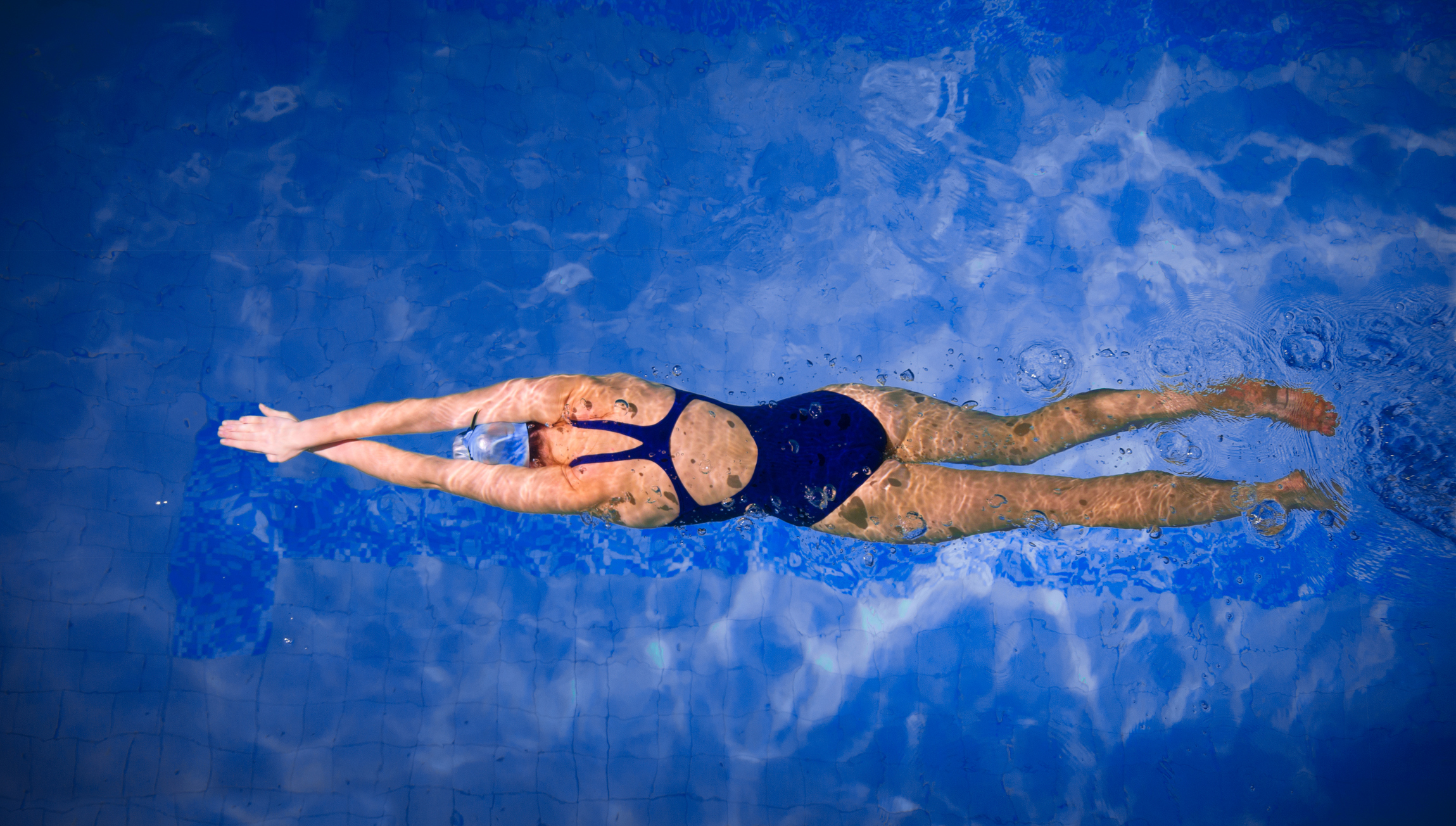 can swimming help you lose weight? - pool brite