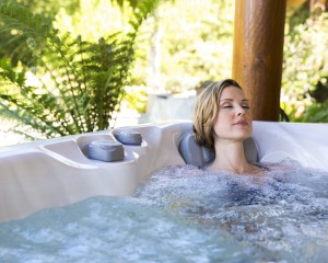 Woman relaxing in a Sundance Spa